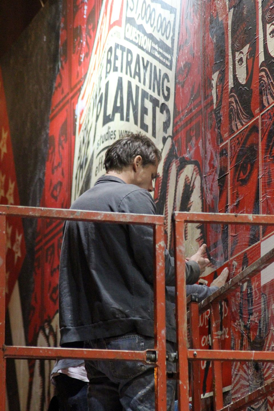 NEW YORK - APRIL 20: Shepard Fairey paints new mural on Deitch Wall on April 20, 2010 in New York City. (Photo by Cory Schwar