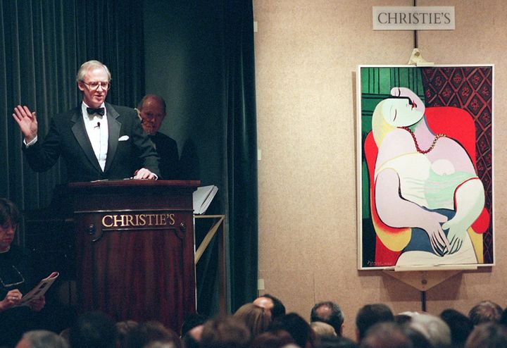 NEW YORK, UNITED STATES:  Christopher Burge, chairman of Christie's (L), starts the bidding for Pablo Picasso's painting, 'Le