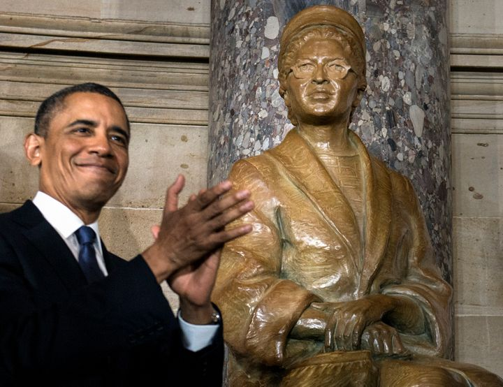 US President Barack Obama applauds after unveiling a statue of Rosa Parks during an unveiling in Statuary Hall on Capitol Hil