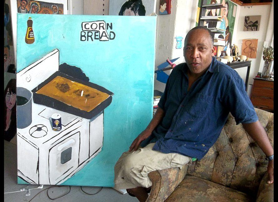 Henry Taylor in his Downtown, Los Angeles art studio, with his corn bread painting, inspired by his late mother, Cora. PHOTO: