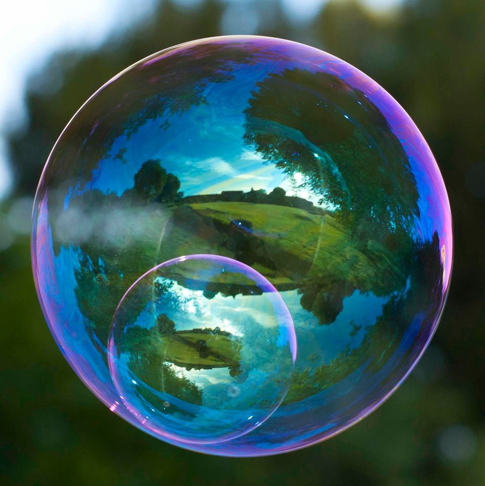 This incredible series of images captured in the reflection of a bubble is enough to blow your mind.
