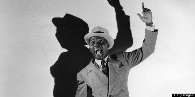 Legendary tap dancer Bill 'Bojangles' Robinson (1878 - 1949) and his shadow perform on stage in New York in 1941.  (Photo by