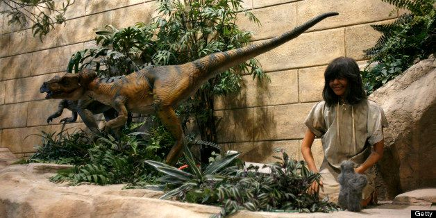 Animatronic dinosaurs and people are throughout the Creation Museum as pictured March 20, 2007, in Petersburg,...