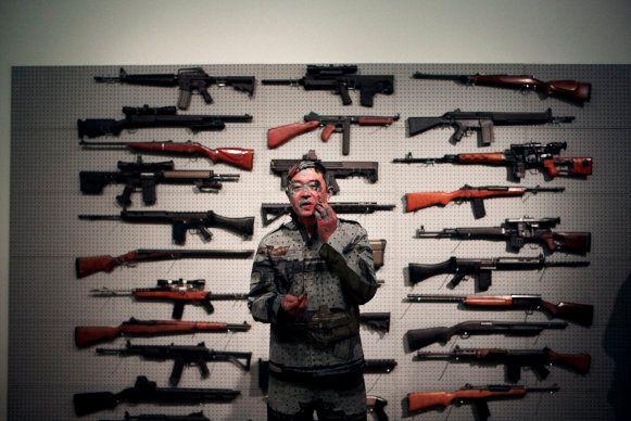 "<a href=""http://www.ekfineart.com/artist/Liu_Bolin/works/"" target=""_blank"">Liu Bolin's</a> ""Gun Rack"" Performance. Courtesy Z"
