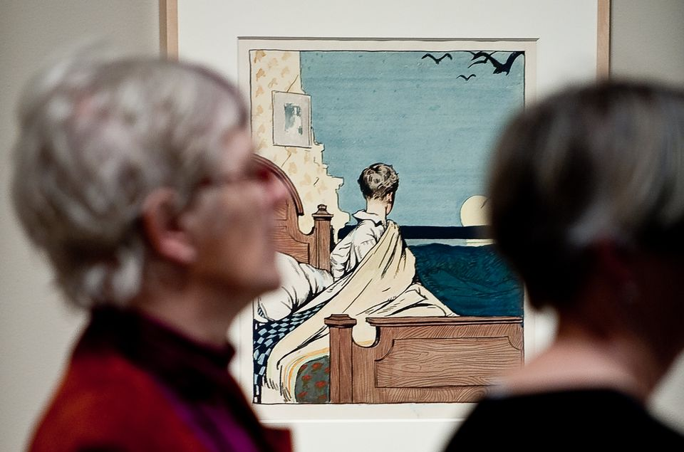 A visitor looks at 'The boy and the moon' painting by US artist Edward Hopper on February 24, 2010 during the first opening o