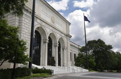 In a June 13, 2013 photo, the front entrance to the Detroit Institute of Arts in Detroit is seen. In a quest to balance the