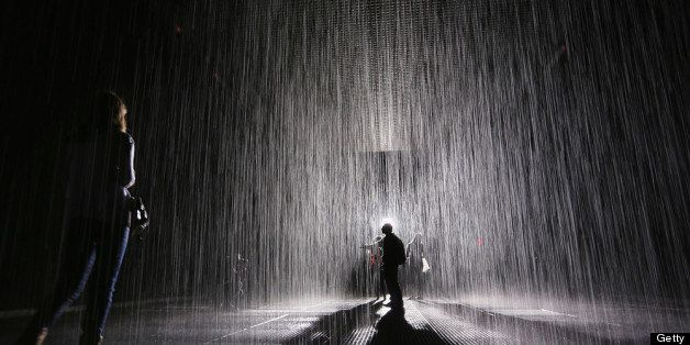 NEW YORK, NY - MAY 15:  Visitors gather in the new 'Rain Room' installation at the Museum of Modern Art (MoMA) in Manhattan o