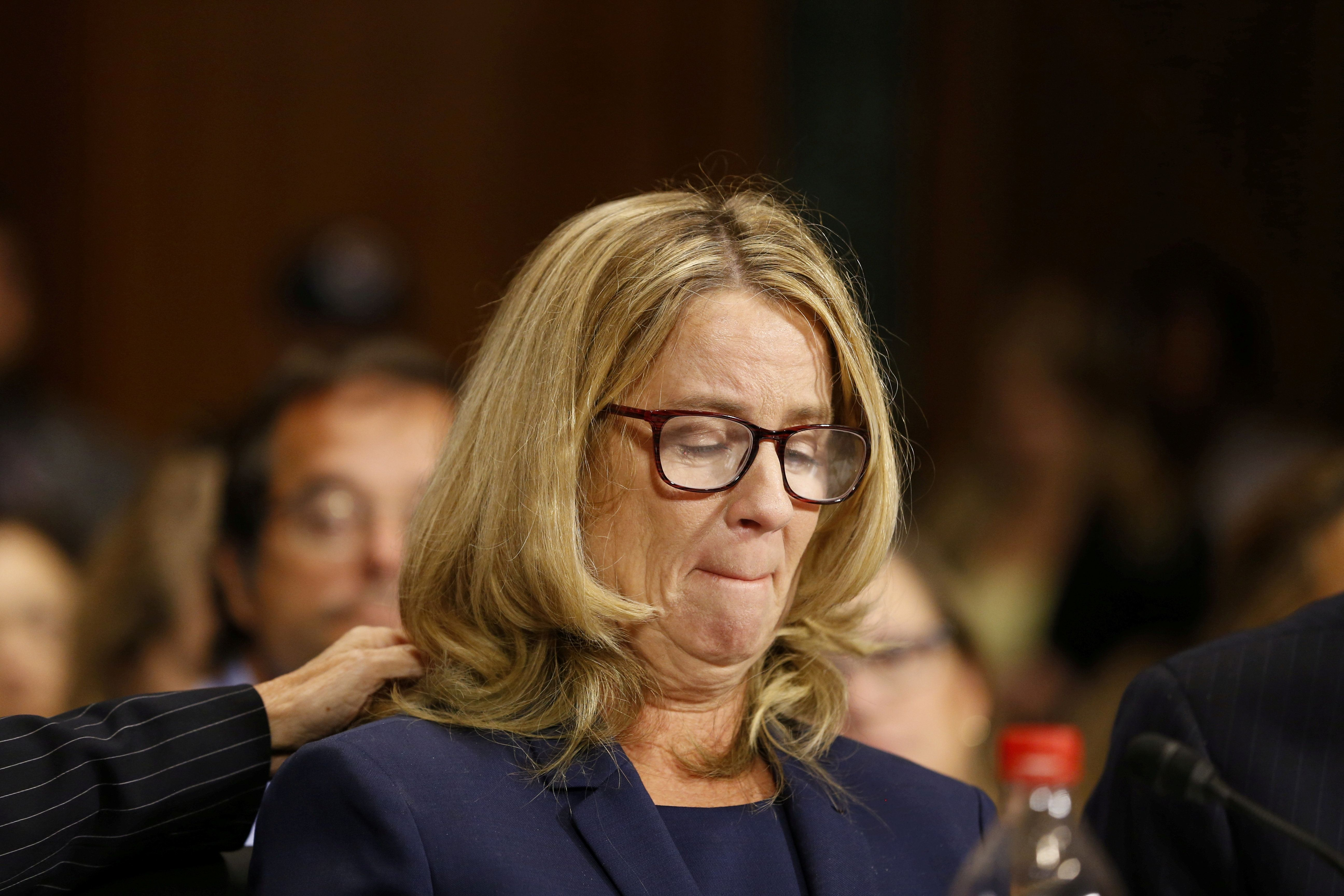 Christine Blasey Ford reacts as she speaks before the Senate Judiciary Committee hearing on the nomination of Brett Kavanaugh to be an associate justice of the Supreme Court of the United States, on Capitol Hill in Washington, DC, U.S., September 27, 2018. Michael Reynolds/Pool via REUTERS      TPX IMAGES OF THE DAY