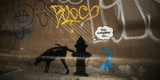 NEW YORK, NY - OCTOBER 03:  A new Bansky work on a side of a wall is viewed on October 3, 2013 in New York City. New work by