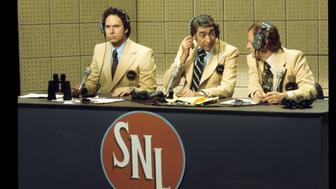 SATURDAY NIGHT LIVE WITH HOWARD COSELL - Show Coverage - Airdate: October 24, 1975. (Photo by ABC Photo Archives/ABC via Getty Images) L-R: CHRISTOPHER GUEST;HOWARD COSELL;JOHN BYNER