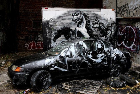"""British street artist, Banksy completed a month-long artist residency on the streets of New York in October titled """"Better Ou"""