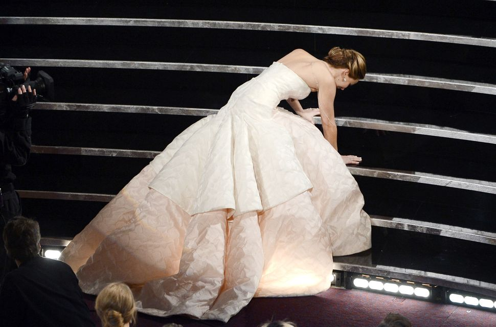 Actress Jennifer Lawrence stumbled and fell as she walked on stage to accept the award for best actress in a leading role for