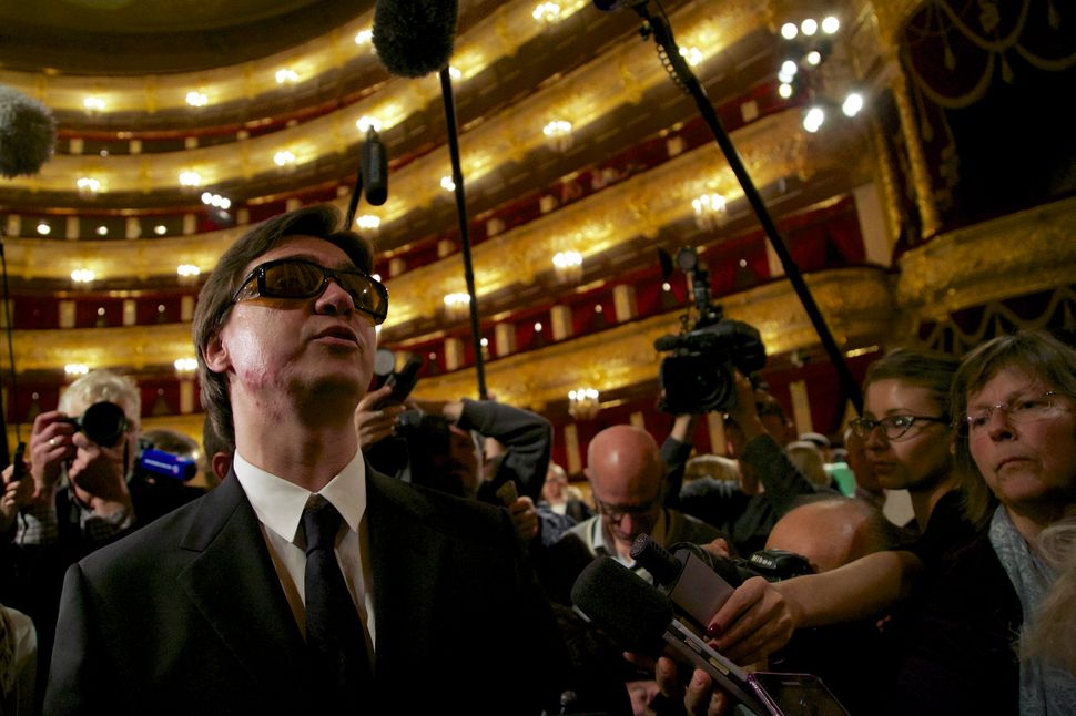 The Bolshoi Ballet's Artistic Director Sergei Filin (left), who was the victim of a horrific acid attack in January, attends
