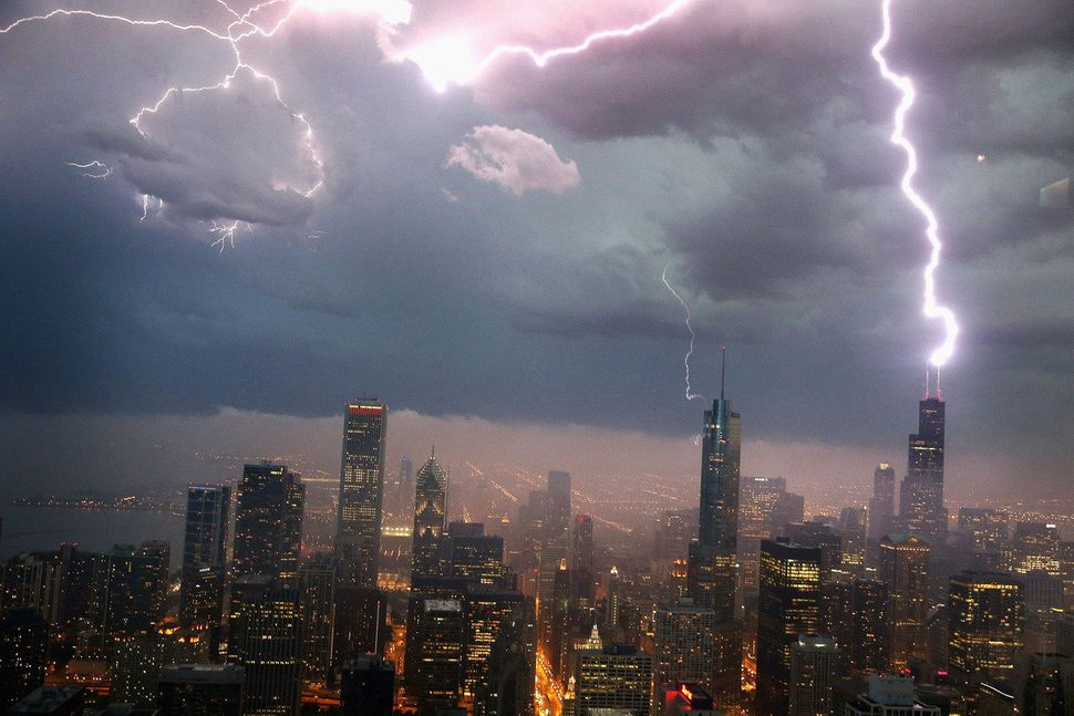 Lightning strikes the Willis Tower (formerly Sears Tower) in downtown on June 12, 2013 in Chicago, Illinois. A massive storm
