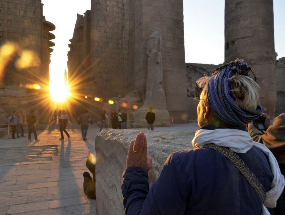 A tourist makes a sunrise visit to the temple of Karnak on the day of the winter solstice in Luxor, 510 kilometers (320 miles
