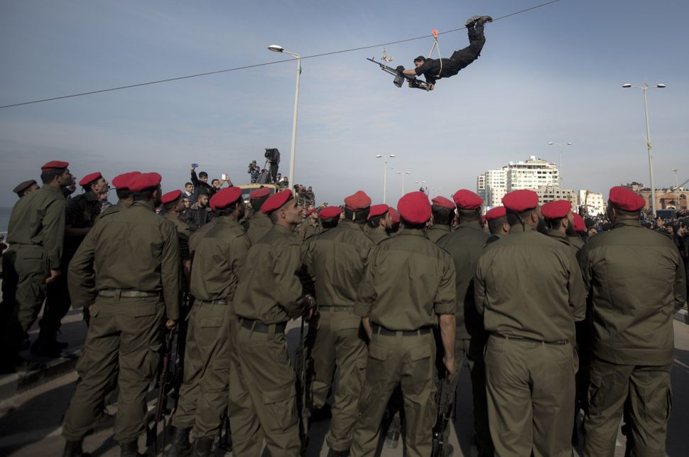 Hamas security forces show their skills during a military parade in Gaza city on January 13, 2014, marking the fifth annivers