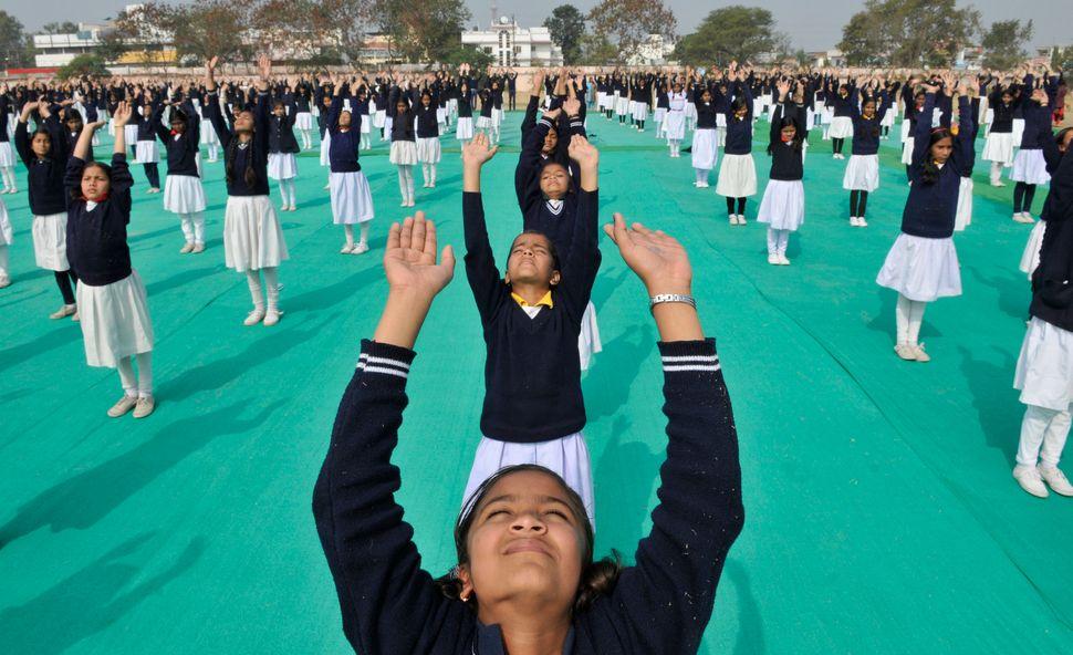 Children perform Surya Namaskar organised a day after, birth anniversary of Swami Vivekananda on January 13, 2014 in Bhopal,