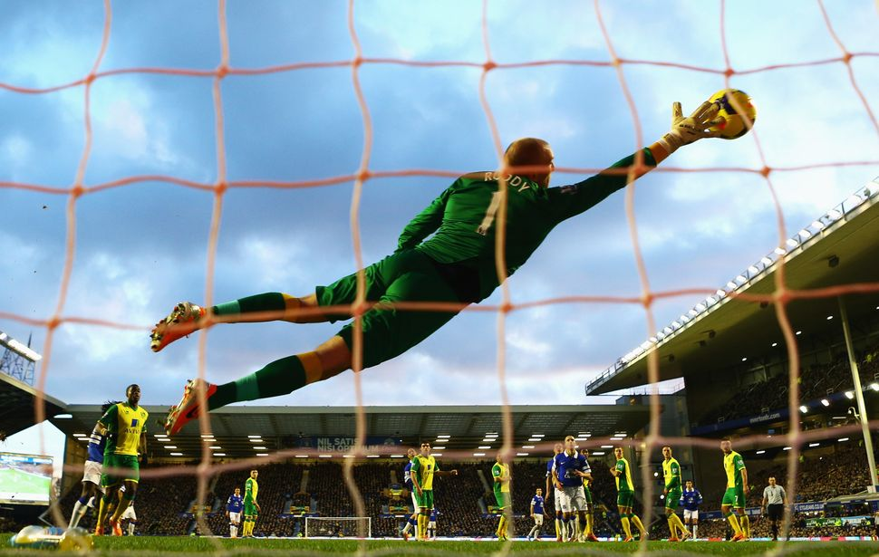 John Ruddy of Norwich City fails to stop the free kick by Kevin Mirallas of Everton during the Barclays Premier League match
