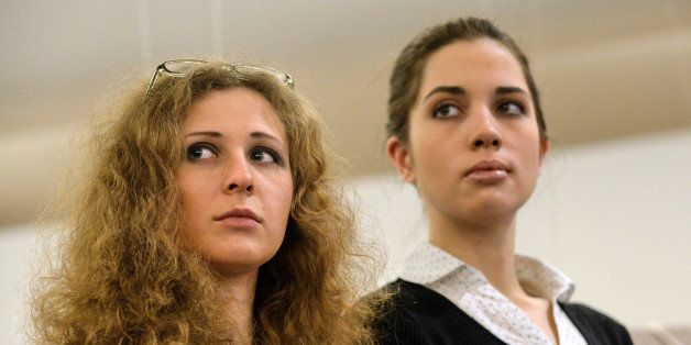 Members of the Russian punk rock band Pussy Riot Maria Alyokhina (L) and Nadezhda Tolokonnikova (R) attend a preview of the n