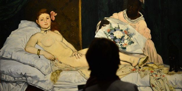 A woman looks at Edouard Manet's 'Olympia' on April 23, 2013 in Venice, during  the 'Manet Return to Venice' exhibition, whic