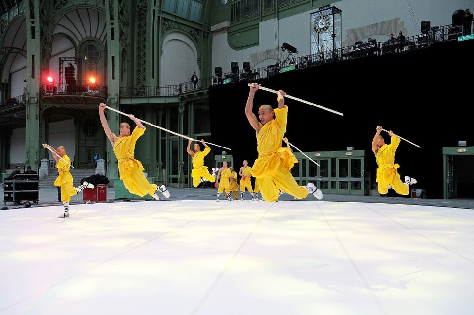 The Performing Troupe of the Tagou Martial Arts School, Henan rehearse during the 'Nuit De La Chine' rehearsal at the Grand P