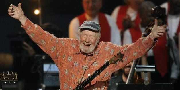 Folk music legend Pete Seeger acknowledges the crowd during a concert marking his 90th birthday at Madison Square Garden in N