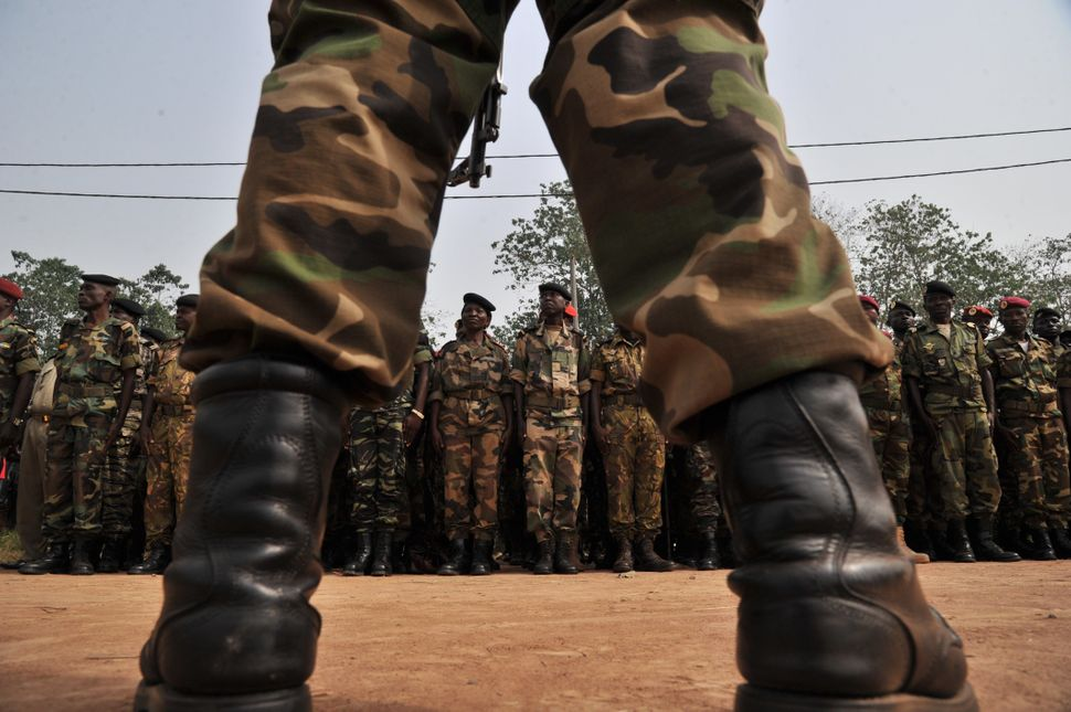 Members of the Central African Armed Forces (FACA) listen to interim president Catherine Samba Panza's speech on February 5,