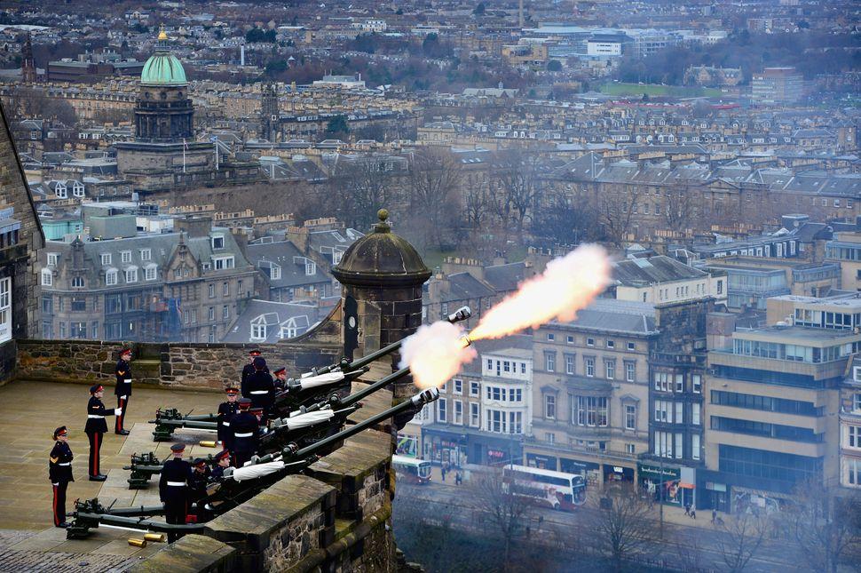 Gunners from 105th Regiment Royal Artillery fire a 21-Gun Royal Salute at Edinburgh Castle on on February 6, 2014 in Edinburg