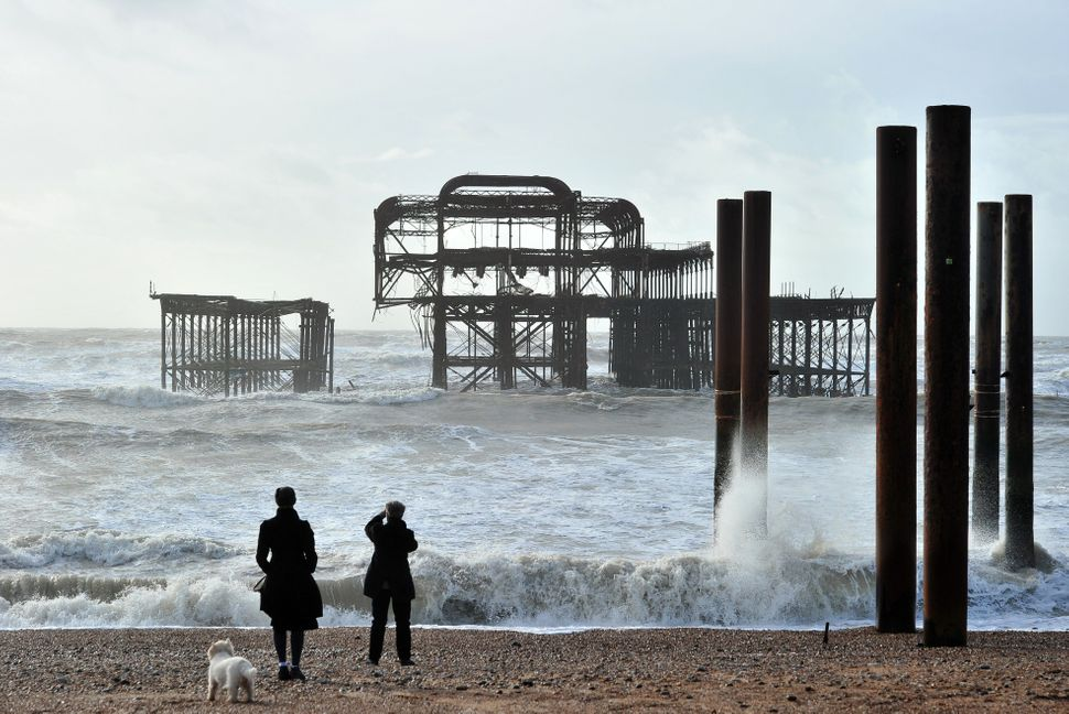 Brighton's West Pier in southern England is divided into two parts after rough seas caused a section on the east side to coll