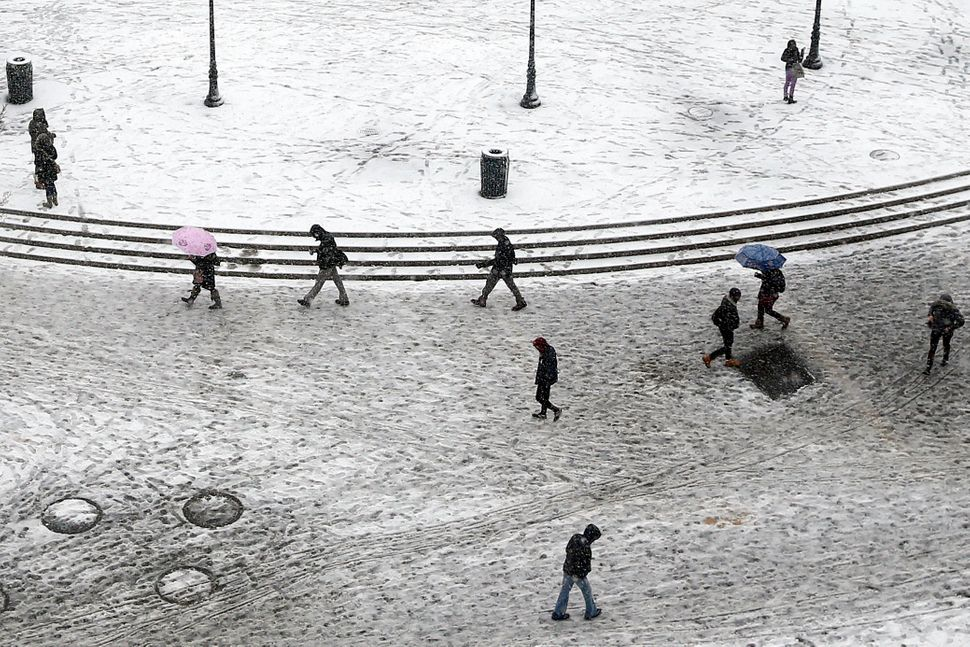 Pedestrians trudge through dirty snow and slush as they pass through Union Square Monday, Feb. 3, 2014, in New York. Another
