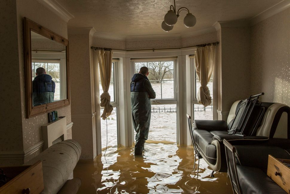 Matt Beesley looks out of the window in his flooded living room that faces onto the River Severn on February 12, 2014 in Worc