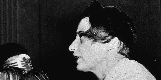 Russian-born author and philosopher Ayn Rand (1905 - 1982) speaks at microphones, discussing the film, 'Song of Russia,' New