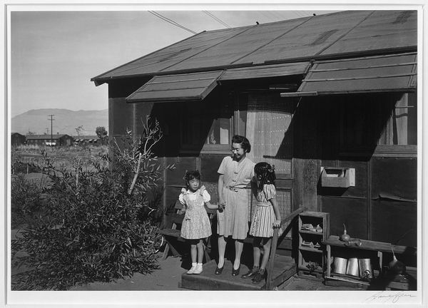 """<a href=""""http://www.anseladams.com/the-girls-of-manzanar/"""" target=""""_blank"""">Mrs. Nakamura And Her Daughters</a>"""
