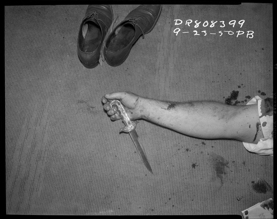 Shoes, arm and knife Date: 9/23/1950