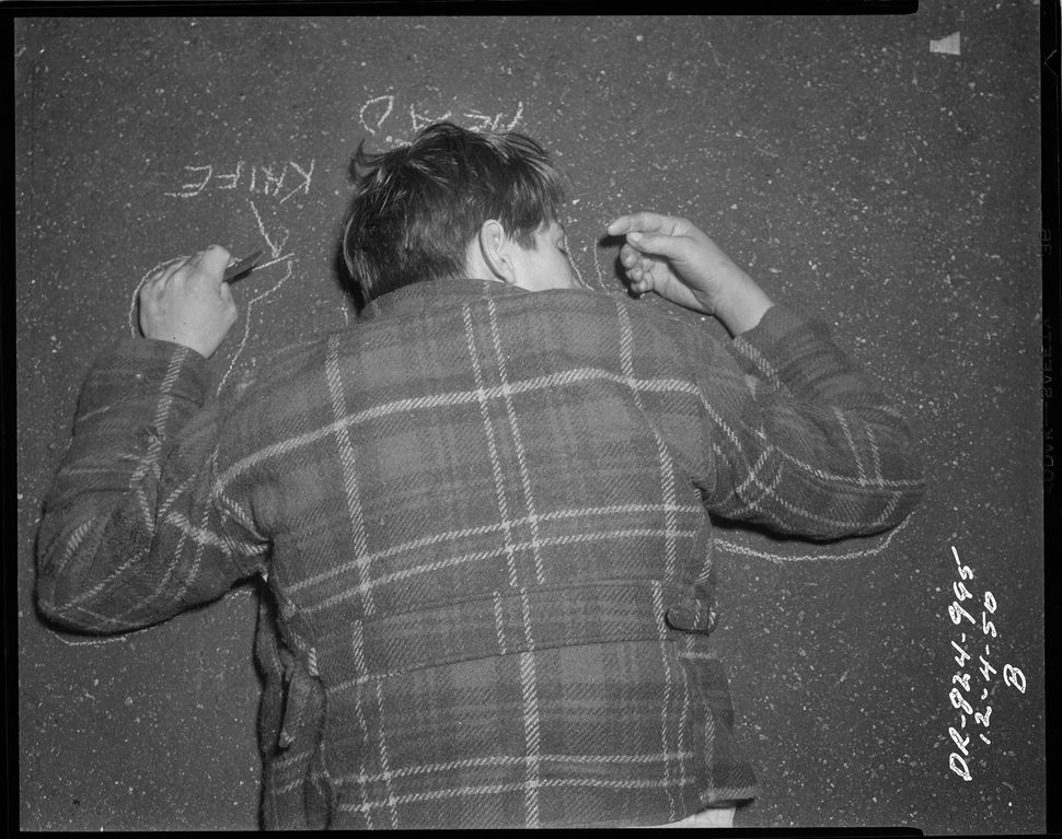Chalk outline detailing position of head with knife in hand. Case information unknown. Date: 12/4/1950