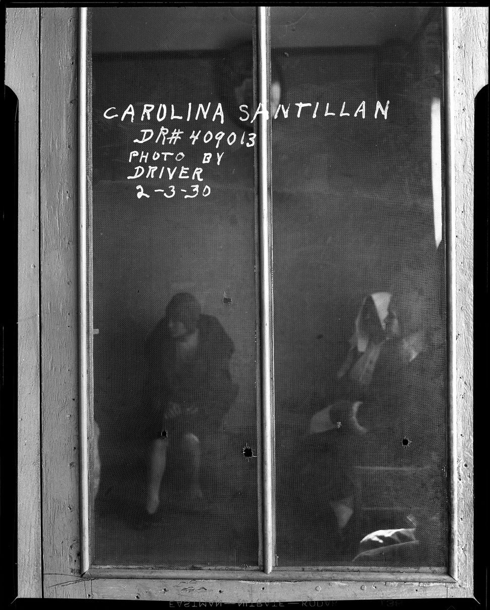 Detail of bullet holes in screen Date: 2/3/1930