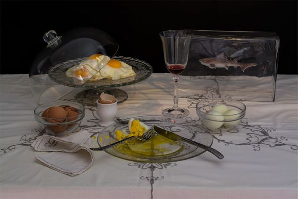 "Saatchi, ""The egg diet"" - Nine eggs in all the possible shapes, a glass of wine and a small tank with a shark - his well know"