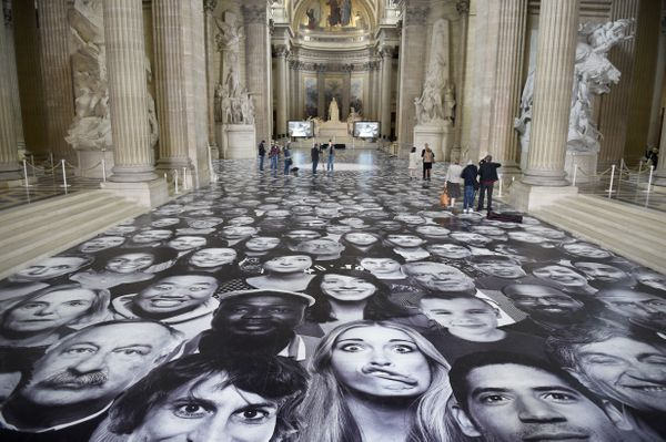 """People visit the exhibition """"Au Pantheon!"""" by French photographer JR at the Pantheon in Paris, a secular temple which contain"""