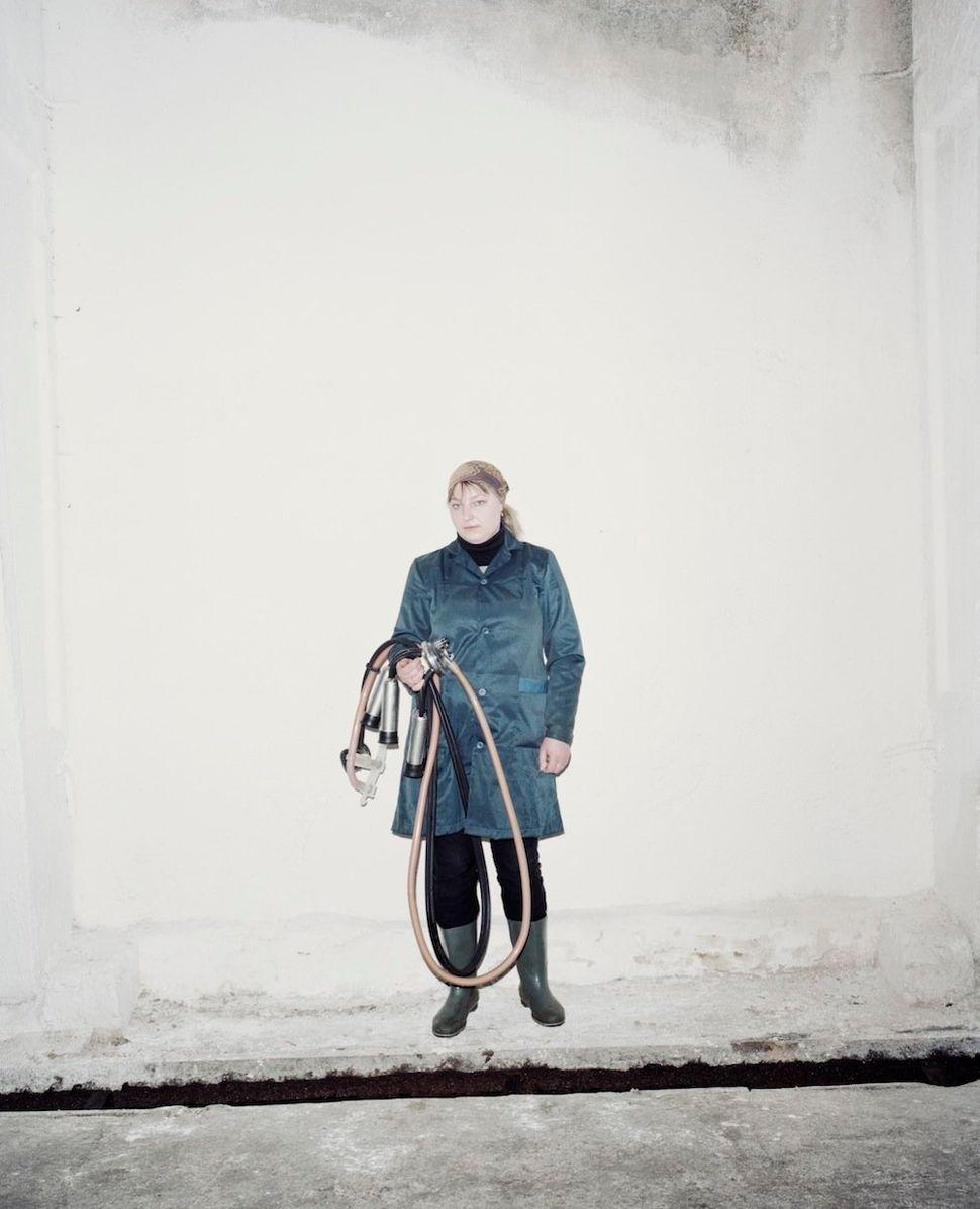 Elena, the best milkmaid of the Slutsk region.