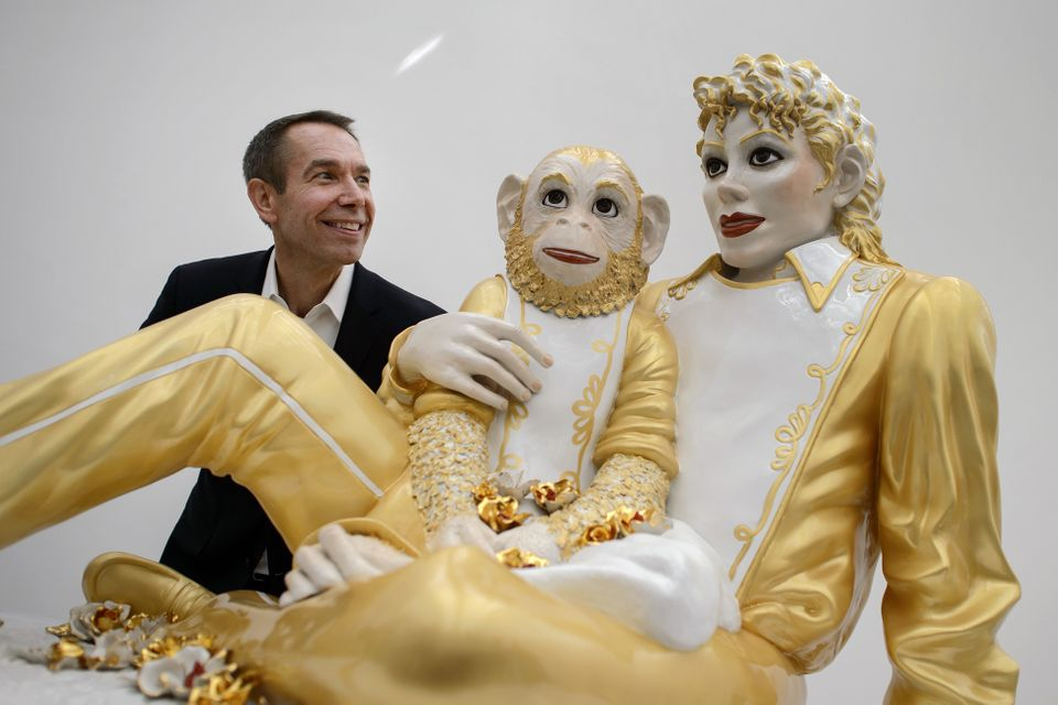 US artist Jeff Koons' poses next to 'Michael Jackson and Bubbles' sculpture on May 11, 2012 during an exhibition preview at t