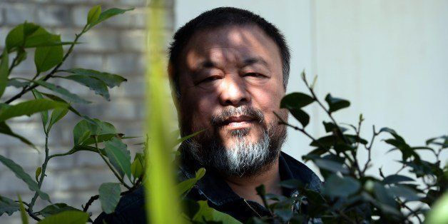 China's best known and boldest contemporary artist, Ai Weiwei, poses in the garden of his studio in the suburbs of Beijing on