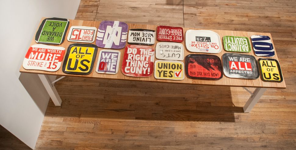 Katie Ostler  Workers Protest Platters 2013 -14  17 platters  glazed ceramics  dimensions variable by piece