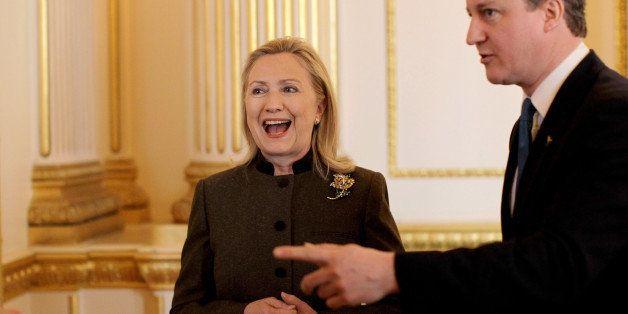 LONDON - FEBRUARY 23:  British Prime Minister David Cameron talks to U.S. Secretary of State Hillary Clinton during the Somal