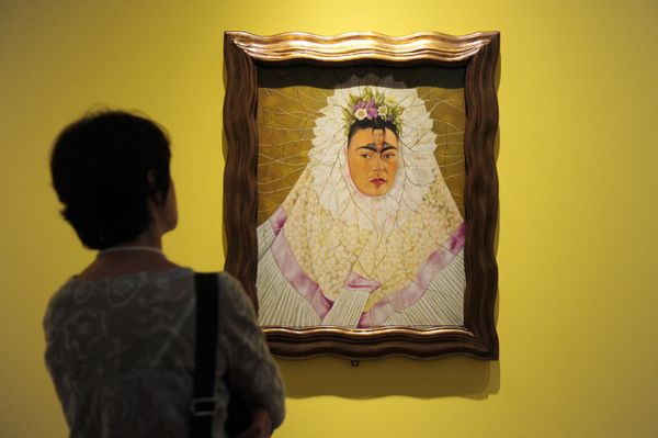 A photographer takes pictures of the painting 'Self-Portrait as Tehuana or Diego on My Mind' by Mexican artist Frida Kahlo du