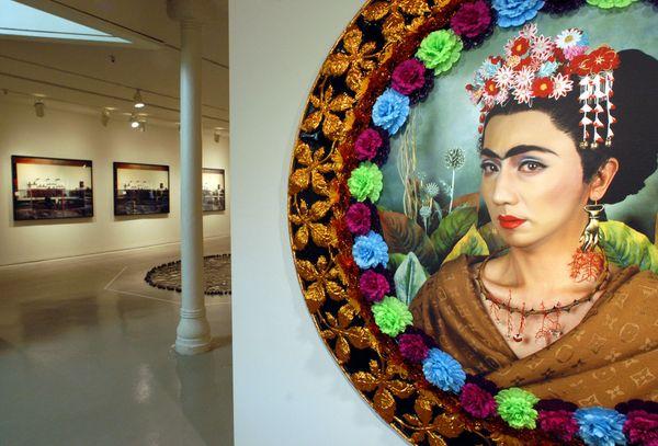 A photographic self-portrait of Japanese artist Yasumasa Morimura dressed as Mexican artist Frida Kahlo, hangs in the Institu