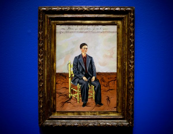 """This Feb. 8, 2013 photo shows Frida Kahlo's 1942 """"Self Portrait with Cropped Hair"""" part of the exhibition featuring the works"""