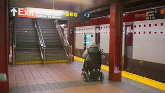 Handicapped man in wheelchair waiting for subway train. (Photo by: Education Images/UIG via Getty Images)