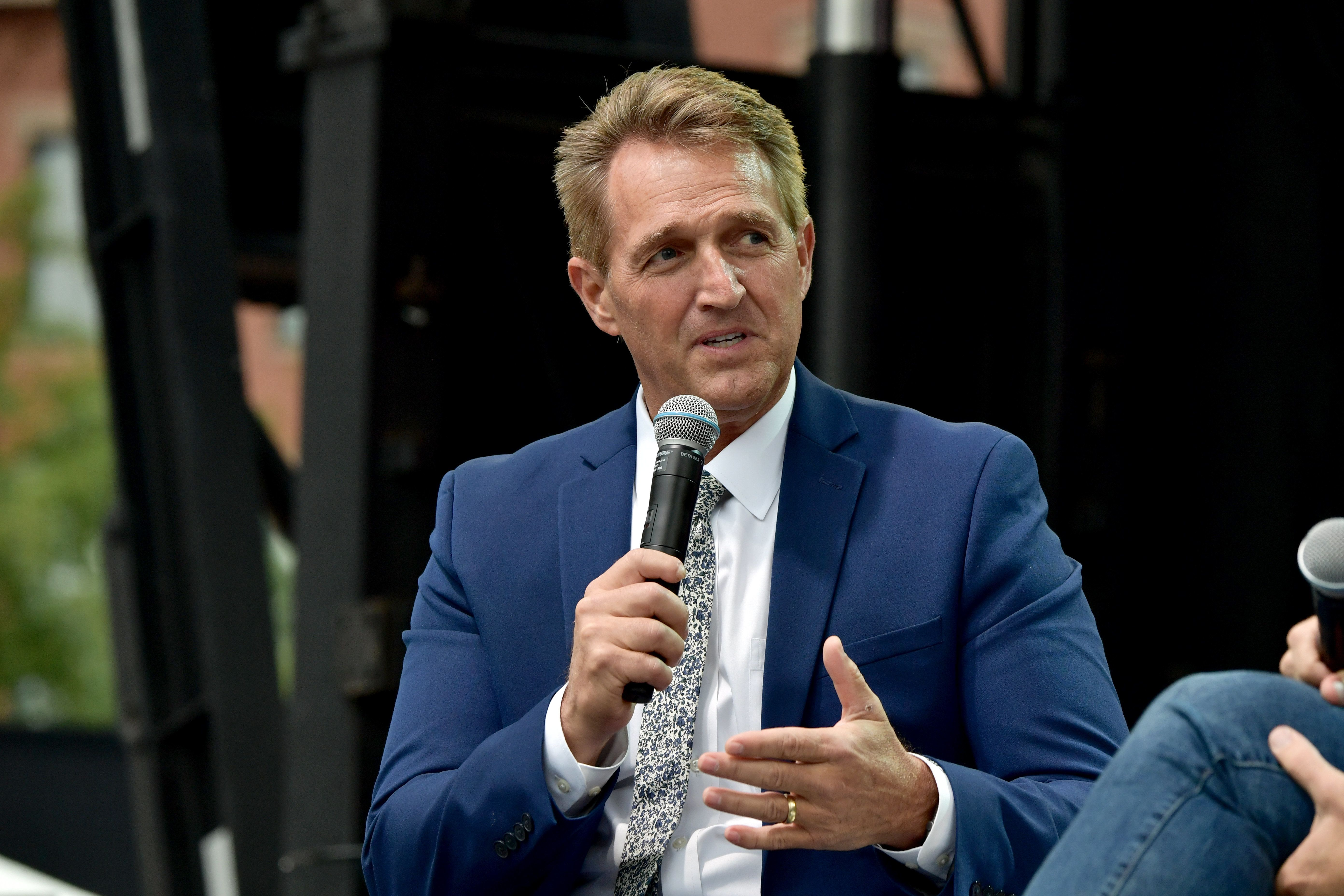 BOSTON, MA - OCTOBER 01: Sen. Jeff Flake (R-AZ) speaks at Forbes Under 30 at 'Lunch with Jeff Flake' at Boston City Hall Plaza on October 1, 2018 in Boston, Massachusetts. There was a rally outside the event calling on Sen. Flake to reject Judge Brett Kavanaugh's nomination to the Supreme Court. Flake recently called for a one week pause in the confirmation process to give the FBI more time to investigate sexual assault allegations. (Photo by Paul Marotta/Getty Images)