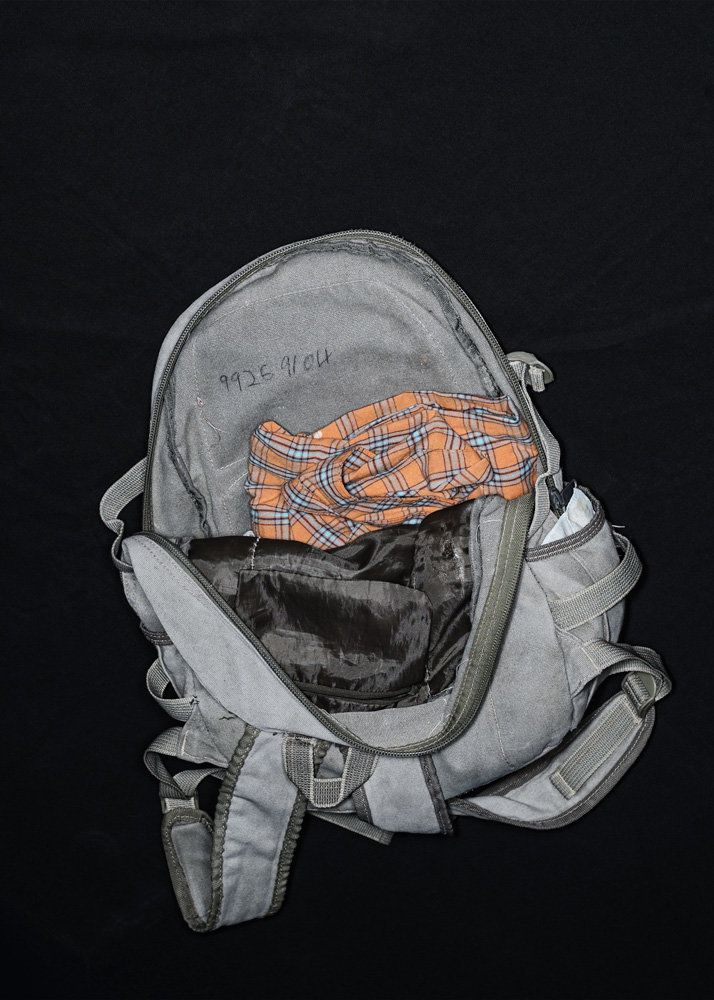 """The Backpack of Salvador Santo. Salvador Santo, 21, has written inside the phone number of a relative in Honduras. The need"