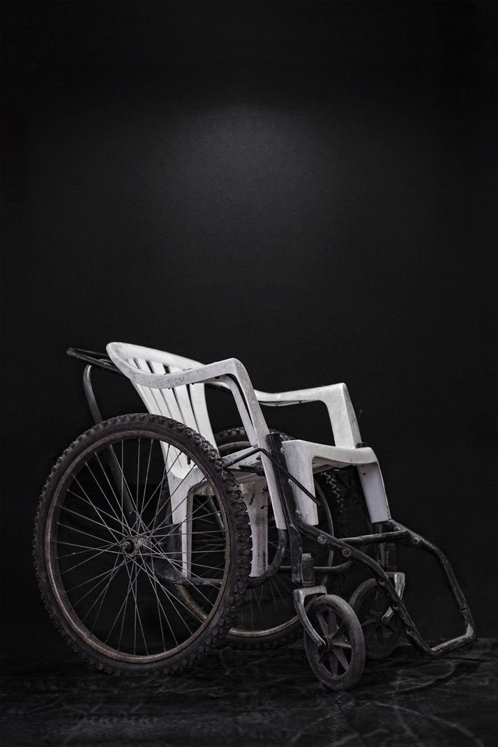 """Wheelchair, adapted from a plastic garden seat. It is a work donated by the International Organization -- <a href=""http://ww"
